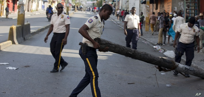 Haiti police removing protestor barricades